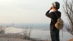 Child looks through binocular - stock footage