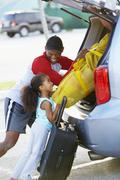 African american father and daughter loading car Stock Photos