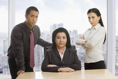 Business people posing in office Stock Photos