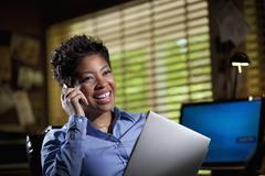Black businesswoman in office using cell phone Stock Photos