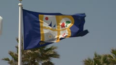 Huntington Beach flag blowing in wind Stock Footage