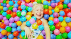 Young Child Playing Ball Filled  Pool - stock footage