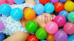 Caucasian Child Playing Ball Pool Stock Footage