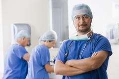 Surgeons scrubbing in before operating Stock Photos