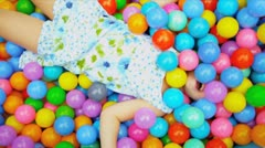 Close Up Caucasian Child Playing Ball Pool - stock footage