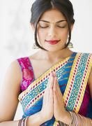 Mixed race woman in traditional indian clothing Stock Photos