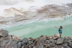 Hispanic woman hiking hear glacial lake Stock Photos