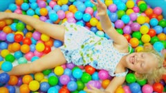 Young Child Playing Ball Filled  Pool Stock Footage
