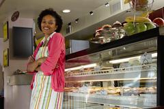 African american bakery owner standing in shop Stock Photos