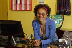 African american small business owner in clothing shop Stock Photos