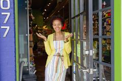 African american small business owner standing in doorway Stock Photos