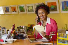 African american small business owner working in shop Stock Photos