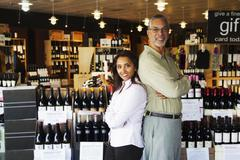 small business owners working in wine shop - stock photo