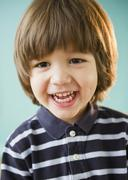 Grinning hispanic boy Stock Photos