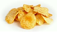 Potato chips are rotating on white Stock Footage