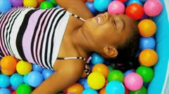 Little African American Girl in Ball Pool Stock Footage