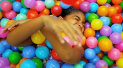 Little Caucasian Girl in Ball Pool - stock footage