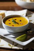 Curry soup in bowl with garnish Stock Photos