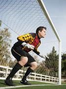 Mixed race goalkeeper protecting goal Stock Photos