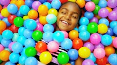 Young Ethnic Child Playing Ball Filled  Pool Stock Footage