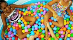 Childhood Friends Enjoying Ball Pool Stock Footage
