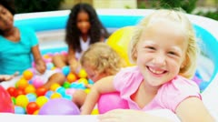 Young Multi Ethnic Girls Playing Ball Filled  Pool Stock Footage