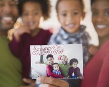 black family holding seasonís greetings photograph black family holding season's - stock photo