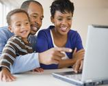 Stock Photo of black family using laptop together