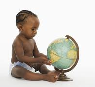 African american baby looking at globe Stock Photos