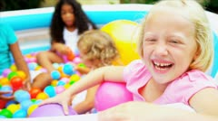 Laughing Little Girls Playing Plastic Balls Stock Footage