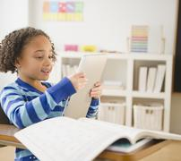 African american girl looking at digital tablet Stock Photos