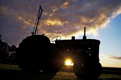 Vintage tractor at sunset Stock Photos