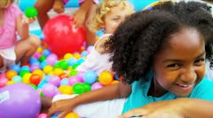 Laughing Multi Ethnic Children Enjoying Ball Pool Stock Footage