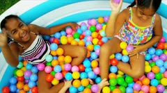 Sisters Childhood Fun in Garden Pool Stock Footage