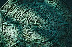 green aztec calendar stone carving - stock photo