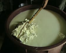 CHEESE mixing the curd AUDIO Stock Footage