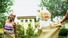 Cute Multi Ethnic Girls Garden Fun Races - stock footage