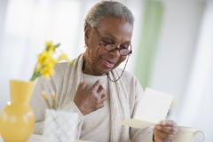 Black woman reading letter Stock Photos