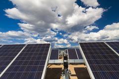 Blue sky over solar panels Stock Photos