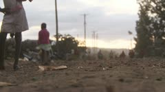 Kids feet on slum street Stock Footage