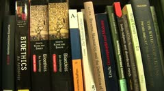 """Books about """"bioethics"""" in Jacob and Wilhelm Grimm-Center in Berlin Stock Footage"""