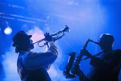 Musicians playing in jazz band on stage Stock Photos