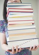 Korean woman holding stack of books Stock Photos