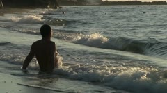 Man sitting in sea. Morning time. Stock Footage