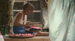 Eldery Woman Making Crafts in Manila Slum Stock Footage