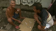 Filipino Men Play Checkers in Squatter Neighborhood Stock Footage
