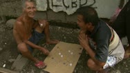 Stock Video Footage of Filipino Men Play Checkers in Squatter Neighborhood