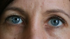 Staring blue eyes. - stock footage