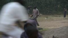 Man driving wheelbarrow and eating sugarcane Stock Footage