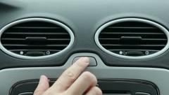 Hand pushes the car emergency button Stock Footage